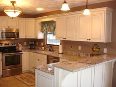 LOVE this kitchen! Canvas with cocoa glaze cabinets. Bianco Antico countertop