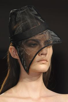 Frankie Morello - A hat that could have lots of drama but in lime green or something, not black.