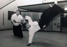 Rev. Kensho Furuya sweeping Ken Watanabe with a jo.