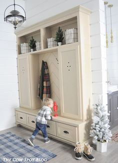 Festive Mudroom. Designed by Courtney Shearer with Bell Custom Cabinets. Maple Wood.
