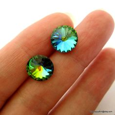Dragon Eye Huge Glittering Stud Earrings - Green,  Hot Pink and Deep Teal - Stunning. $19.99, via Etsy.