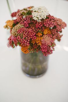 Yellow Yarrow Floral Arrangement: Ideal for a rustic wedding theme, yarrow is traditionally a wildflower, and retains a simple aesthetic. Like coxcomb, it presents itself well either fresh or dried and ranges in color from neutral to bold.