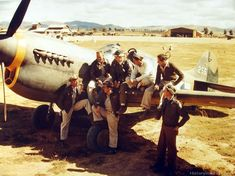 Pilots of Curtiss F-40's of the 26th Fighter Sqd., 51st Fighter Group discuss a mission. China