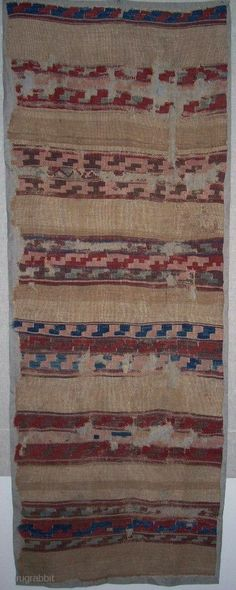 2'7 x 7', a central Anatolian kilim fragment with lots of camel wool and early symbolic language, mounted, first half 19th c.