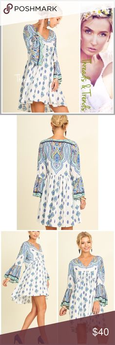 Stunning White Paisley Dress Incredible white dress boasting an array of Blue & yellow colors in a paisley print. The perfect summer dress for that special event. Made of rayon size S/M, M/L, L/XL gingham Threads & Trends Dresses