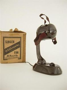 Bakelite Singer Ribbonaire Fan Streamline. My grandmother had one these. Used it for years.