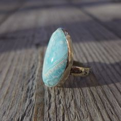 A beautiful lacey Larimar stone, set in sterling silver - this one off ring has a unique hand stamped band.  https://www.etsy.com/listing/177127684/larimar-lace-ring?ref=shop_home_active_3