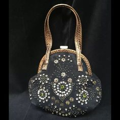 """HP!🎉👠🎀🛍 Rafe New York Black Suede Beaded Purse By Rafe New York Clasp closure Suede exterior features embellished front details and snake skin trim Metal, plastic, glass bead and rhinestone detail Flat gold snakeskin handles  Shoulder Strap Drop: 4.5""""  Fabric Lining  Brand new with tags  Interior slip pocket  7.5""""W X 7""""H X 3""""D Imported Comes with the original dust bag and a package of additional beads. Rafe New York Bags"""