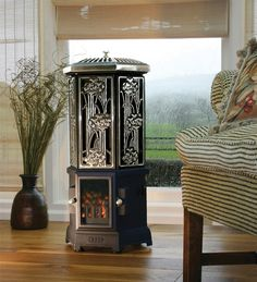 The Esse Solo Electric Stove adds warmth to a conservatory or summer house with style and elegance, in a choice of black or fully polished model (as shown). Hand crafted in quality cast iron, the Esse Solo electric heater is both durable and efficient, Stove Heater, Pellet Stove, Gas Stove, Portable Electric Fireplace, Wall Mount Electric Fireplace, Electric Fireplaces, Electric Stove, Gas And Electric, Leeds