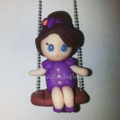 Bambolina su altalena realizzata in Fimo