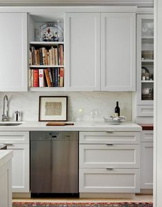Contemporary Kitchen with Standard height, stone tile floors, Kitchen island, One-wall, Flat panel cabinets, wall oven, Paint