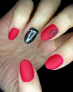 Red matte gel nails with diamantes and nail art