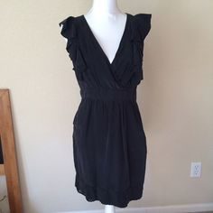 """Bebe Black Silk Ruffle Dress Adorable LBD from bebe. Ruffles on the top, the bottom had cute little pockets. She'll is 100% silk, lining 100% polyester. Minor flaw can be seen in last pic - a safety pin was used on the v-neck. Also the belt is missing but the loops could be removed easily without being noticed. Measures: length 19"""" from waist, 34"""" from shoulder. Chest 18"""" (front), 15"""" waist (front). bebe Dresses Mini"""