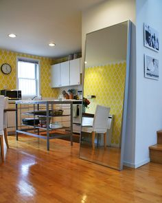 yellow stencil wallpaper for the kitchen