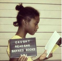 this would be fun to do with a high school class...let them pick from a list of banned books, have them read the book, then take mug shots like this, but with the book cover visible