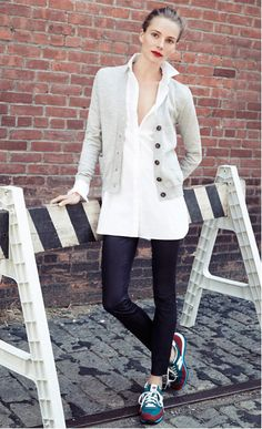 Sneakers, black skinny jeans, light grey cardigan, white button-up shirt, red lips