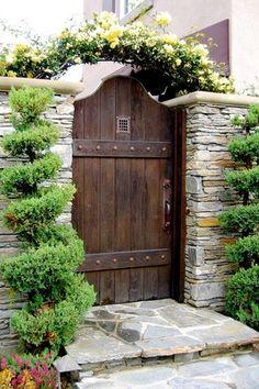 Mediterranean Landscape/Yard with Wheeler Zamaroni Flagstone exterior stone floors Custom Private Garden Gate Pathway & Iron Door Viewer