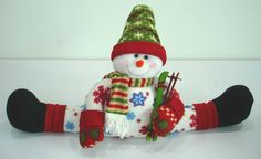 Snowman draft stopper - Keep the cold from seeping under your door or window sill while decorating your home with this adorable draft dodger. Snowman Decorations, Christmas Door Decorations, Snowman Crafts, Christmas Wreaths, Christmas Crafts, Christmas Ornaments, Christmas Mom, Christmas Sewing, Christmas Snowman