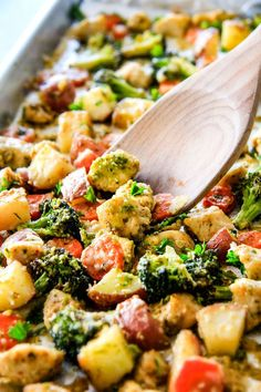 Sheet Pan Parmesan Pesto Chicken, Potatoes, Broccoli and Carrots bursting with flavor and SO EASY!! practically one pan prep making this ideal weeknight meal!