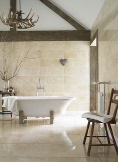 Topps Tiles - like the swirly detail on the tiles above the bath - and the heart decoration - and the  old wooden door!