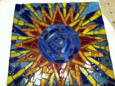 Glass mosaic stepping stone.