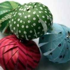 Paper Lantern Ornaments.  String several together and add small white lights.  Perfect for an outdoor party!
