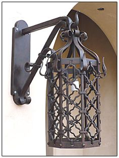 Scrolls scrolls scrolls wrought iron outdoor lanterns wrought iron lamps mozeypictures Choice Image