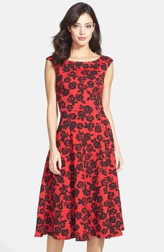 """Betsey Johnson Floral Jacquard Fit & Flare Midi Dress  Romantic blossoms pattern a rich, textured dress styled with demure cap sleeves and a sophisticated midi-length hem.  45"""" length (size 8). Hidden back-zip closure. Lined bodice. 85% polyester, 13% rayon, 2% spandex. Dry clean. By Betsey Johnson; imported."""