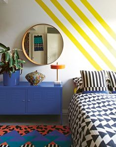 Vintage Bedroom bedroom with blue dresser, yellow striped walls, round mirror - The pop-inspired artist's home is everything we hoped it would be Memphis Design, Retro Bedrooms, Trendy Bedroom, 1980s Bedroom, Yellow Bedrooms, Luxury Bedrooms, Master Bedrooms, Home Decor Bedroom, Bedroom Wall