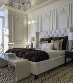Master Bedroom - Exquisitely detailed mill work, sparkling crystal chandelier, tufted headboard + one gorgeous throw.