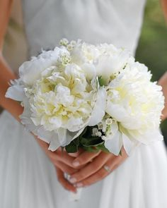 Classic Bouquet, A bouquet of white peonies and lily of the valley appeals to the uber-classic bride.