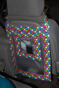 I got this idea from a cloth version of a car organizer for kids. I used a two…