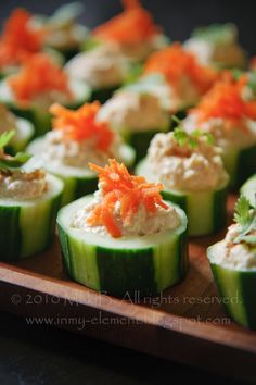 Hummus in Cucumber Cups - big hit with guests and so easy to make. Used a teaspoon to scoop out the middle.