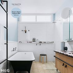 This gorgeous family bathroom, designed by Arent & Pyke for a Sydney family of four hits the right note. A calm blue is brought to life with a richly veined marble vanity top with leather handles and a contemporary footed black bathtub and diamond motif floor tiles. See the whole home in the August 2016 issue of Australian House & Garden. Photograph by Felix Forest.