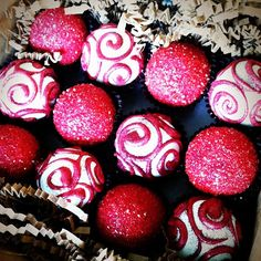 cake ballers cake balls! Red and white sparkly holiday fun balls. www.thecakeballers.com #thecakeballers #red #sparkly #treats #swirl