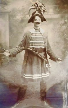 "Photo postcard of a female actor as the Pirate King in an unauthorized 1911 production of ""The Pirates of Penzance,"" possible at an unidentified all-girls school. Dated 1911 on the back."