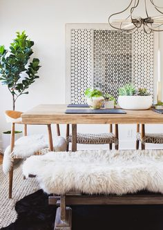 Using a faux fur throw #blanket for a long dining bench adds comfort and #decor at home