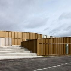 Ateliers+O-S+adds+golden+metal+walls+to++cultural+centre+beside+a+French+cemetery
