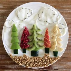 T R E E S . Fruit, yogurt, chia seeds and granola for fun food art, and healthy snack. #foodart #fruitart #healthy #christmas #christmastrees #trees #healthyplate #healthyfruits #healthykidsfestivefood #yummy #kids #moms