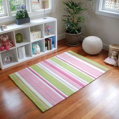 Pink and green striped girls rug.  Pretty pinks, zingy green and white are perfectly paired to brighten a child's space.  Dazzling as a nursery rug, bedside rug or playroom rug.