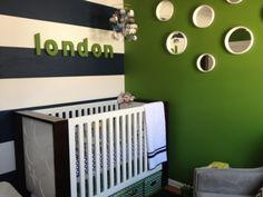 Nursery for biy green white and bold green stripes on wall and elephant themed