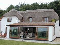 Image result for conservatory with lantern roof with thatched cottage