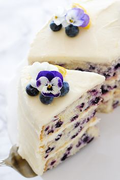 Lemon Blueberry Cake - lemon cake studded with wild blueberries, topped with lemon cream cheese frosting | by Carrie Sellman for TheCakeBlog.com