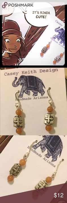 Cute Earrings Drops of carnelian adorn simple crosses on silver plated earwires. An adorable addition to your jewelry box that is sure to get lots of action all year long. Artists signature gift packaging included with purchase . Casey Keith Design Jewelry Earrings