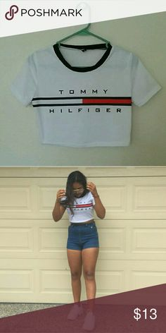 "Tommy Hilfiger crop top !!!!!COMING SOON!!!!!  Brand new. It has ""TOMMY HILFIGER"" printed on the front. Back is plain. Model is wearing the exact shirt. White.   NON-BRANDED  Brand listed is only for viewing purposes.  Tags : brandy Melville urban outfitters nike adidas forever 21  Tommy Hilfiger Zara top shop American American Apparel Tops Crop Tops"