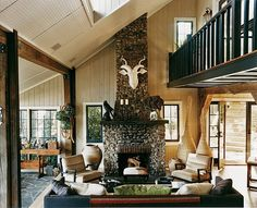 The decor for the home is fresh but also faithful to the home's outdoorsy past, with a graphic palette. Throughout, ceilings were coated in glossy white to replicate the reflective sheen of a boat's hull, with dark, contrasting doors. To achieve woodsiness without seeming to cabin-y, he washed paneled walls in light gray to show off their knots. To further a nature-communing mood, Filicia asked his firewood delivery guy for tree stumps to uses as coffee tables on the deck.