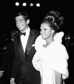 George Hamilton with date, Claudia Martin (Dean Martin's daughter), arrive at the 1965 Academy Awards.