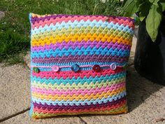 Inspiration: granny stripes with a button fastening along the middle of the cushion.
