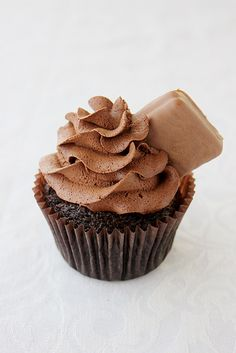 Tim Tam Cupcakes. Chocolate cupcakes with half a Tim Tam biscuit baked inside, covered in whipped chocolate ganache and another half Tim Tam on top! #cupcake #recipe
