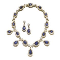 Important sapphire and diamond demi-parure Comprising: a necklace composed of step-cut sapphires within frames of brilliant-cut diamonds, alternating with diamond cluster links, the front highlighted with pear-shaped sapphire and brilliant-cut diamond pendants, length approximately 470mm, French assay marks; and a pair of ear clips, each surmount of cluster design set with brilliant-cut diamonds, suspending a pear-shaped sapphire stated to weigh 9.22 and 9.84 carats respectively, within a…